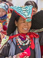 Changpa Nomad woman with turquoise headdress at the Korzok Gustor, Korzok Gompa, Lake Tsomoriri, (Ladakh) Jammu & Kashmir, India. Tsomoriri Lake, (Lad...