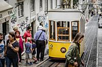 Famous retro yellow tram on the street in Lisbon city, Portugal.