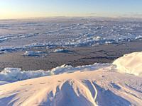 Frozen Disko Bay during winter, West Greenland, Disko Island in the background. America, North America, Greenland, Denmark.