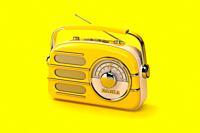 Yellow vintage radio on yellow background. 3d illustration.