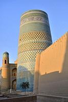 Uzbekistan, Khorezm, Khiva, Unesco World Heritage Site, Old city of Itchan Qala, Kalta Minor minaret and madrasa of Mohammed Amin Khan.