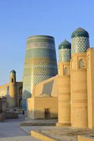 Uzbekistan, Khorezm, Unesco World Heritage Site, Khiva, Old city of Itchan Qala, Kunya Ark (Khoukna Ark) citadel and Kalta Minor minaret.