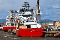 Oil Industry platform support vessels alongside Montrose Angus Scotland.