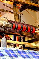 machinery looms weaving tartan clothe. Edinburgh Scotland Uk.