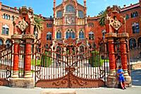 entrance door of the modernist enclosure of the Hospital de la Santa Creu i Sant Pau, architect Lluis Domènech i Montaner, Barcelona, ??Catalonia, Spa...