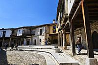 People visiting the medieval square in Cuacos de Yuste, Extremadura (Spain)