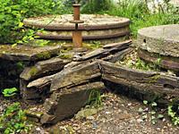 Old and abandoned mill wheels at Mir cascade site. Santa Maria de Besora village countryside. Osona region, Barcelona province, Catalonia, Spain.