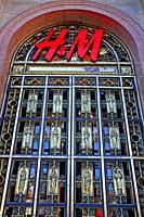 door of the H&M fashion store in the Generali building of Paseo de Gracia, Barcelona, ??Catalonia, Spain