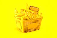 Yellow shopping basket with yellow food on yellow background. Food delivery. 3d illustration.