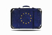 Vintage leather suitcase with flag of European Union isolated on white background.