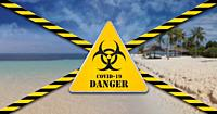 Beach closed due to Coronavirus, Covid19. Caution tape and danger sign, restricted area lockdown.