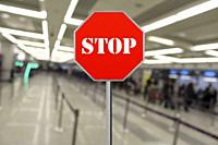 Stop sign at the closed airport due to Coronavirus, Covid19.