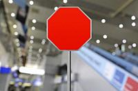 Stop sign for copy space at the closed airport due to Coronavirus, Covid19.