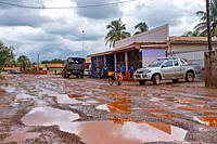 Grocery store along muddy dirt road in the village of Lethem during the rainy season, Upper Takutu-Upper Essequibo region, Guyana, South America