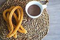 Churros with a cup of chocolate.
