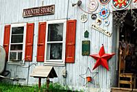 Amish Hex signs and other antiques hang on the exterior wall of a country store in Reading, Pennsylvania.