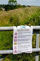 Covid warning sign on farm gate Scotland UK.