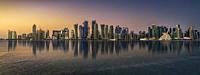 Panoramic view of the Doha skyline at sunset.