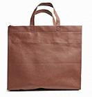 reusable brown viscose bag on a white background, plastic waste reduction concept.