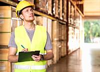 Portrait white caucasian warehouse worker stand with archboard and pen for inventory checking in large warehouse distribution center. Reopening tradit...