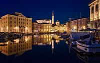 View of the port of Piran at dusk.