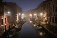 Foggy sunrise on a lonely canal in Venice.