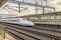 Tokaido Shinkansen train running through Odawara Station, Japan.