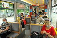Zürich/Switzerland: Face masks are mandatory now on all public transport, such as tram, train and busses in Switzerland like here in Zürich City.