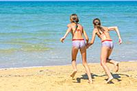 Children with a run run swimming in the sea.