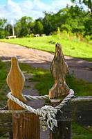 Lidkoping, Sweden A wooden gate and rope lock in a field.