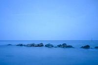 Blue milk water after sunset during the blue hour at Rabylille Beach, Isle of Moen, Denmark.