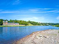 Elbe River landscape with Elbe meadows and historic waterworks Saloppe, today a beer garden, Dresden, Saxony, Germany, Europe.