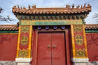 Red door with knocker in Jingshan Park in Beijing, China.