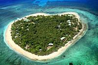 Aerial view of the heart-shaped island of Tavarua, near Viti Levu, Republic of Fiji, South Pacific Islands, Pacific.