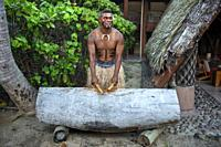 Tradtional Fijian Warrior playing the drum in Malolo Island Resort and Likuliku Resort, Mamanucas island group Fiji.