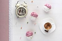 handmade marshmallows near a Cup of coffee and watch the alarm on the lace.
