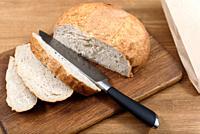 grain bread is sliced on the Board.