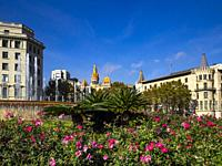 Fountain and garden at Plaça de Catalunya, Barcelona - Catalonia, Spain. Plaça de Catalunya is a large square in central Barcelona regarded as the cit...