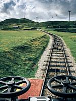 Track of cable-pulled tram leading to summit of Great Orme Country Park and Nature Reserve, Llandudno, Wales, UK.