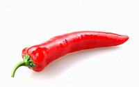 Close-Up Of Red Chili Pepper Against White Background.