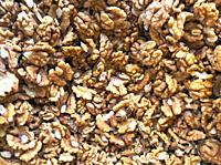 Close-Up Of Peeled Fresh Walnuts Background.