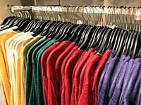 Different types of winter sweaters for sale at a nearby store.