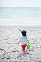 2 years old boy playing at the Beach in the Baltic Sea.