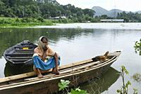 A woman siting on a boat in a flood effected village in Kamrup district of Assam, Monday, July 13, 2020.