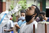 Health worker collecting swab to rapid test for COVID-19 at Kali Mandir, in Pandu area of Guwahati in Assam, India on 8 July 2020. Pandu area of Guwah...