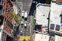 Sydney, New South Wales, Australia - View from above of a street scene with waiting cars at a road junction in the city centre.