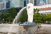 Singapore, Republic of Singapore, Asia - A migrant worker cleans the Merlion statue in Marina Bay after the reopening following the partial lockdown a...