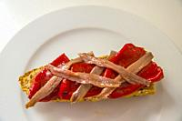 Anchovy fillets with Piquillo peppers on toast. Spain.