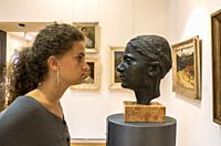 Girl in front of a bust, Modern Gallery, Zagreb, Croatia.