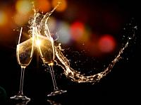 Glasses of champagne with splash, isolated on black.